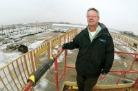 Mark Thompson stands on a lift overlooking the new service area under construction at Thompson Family RV west of Davenpo